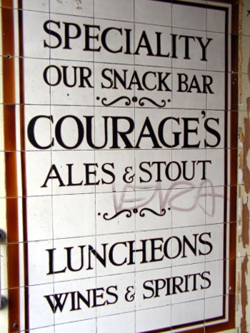 Courage stouts and ales -- a tiled advertisement on a pub in Hackney