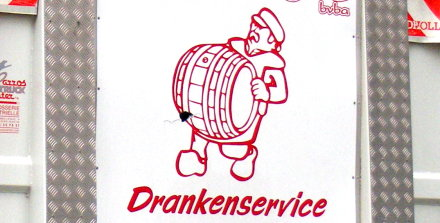 Beer delivery service logo -- drayman carrying barrel.