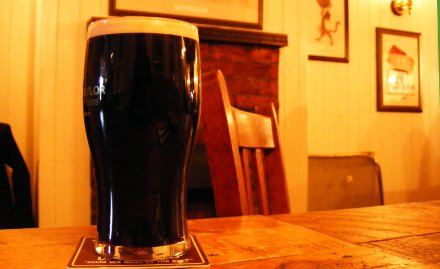A pint of Timothy Taylor's dark mild in a pub.
